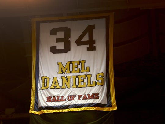 Mel Daniels' #34 hangs high at Bankers Life Fieldhouse, Saturday, October 31, 2015.  A moment of silence was held for the hall of famer who died Friday, October 30, 2015.