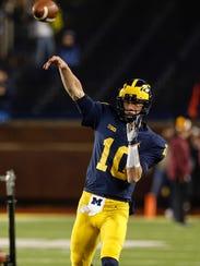 Michigan quarterback Dylan McCaffrey (10) during practice