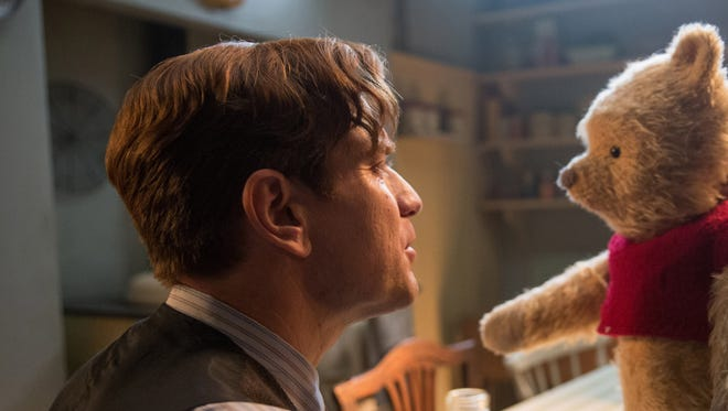 """In """"Christopher Robin,"""" the title character (Ewan McGregor) is reunited with his longtime pal."""