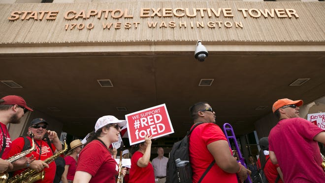 Teachers and other supporters rally during the the third day of the Arizona teacher walkout at the Arizona state Capitol in Phoenix on Monday, April 30, 2018.