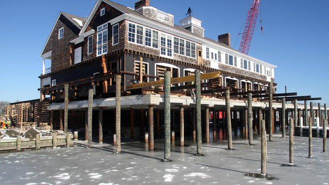 The preserved section of the Bay Head Yacht Club is positioned over new raised steel piles in Bay Head while it was being renovated in January 2014. Mayor Bill Curtis will lead a walk from the Town Center to the newly renovated Yacht Club on Wednesday, July 22.