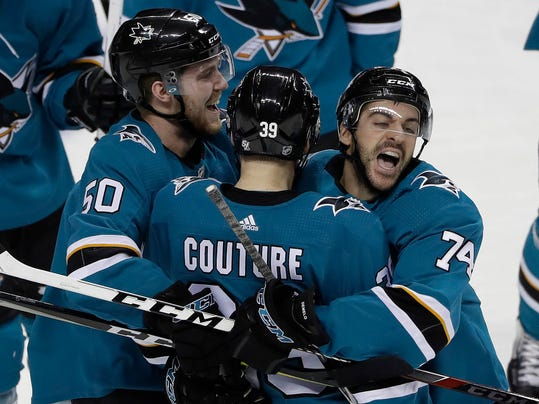 San Jose Sharks' Logan Couture, center, celebrates his game-winning goal with teammates Dylan DeMelo (74) and Chris Tierney (50) in overtime of an NHL hockey game against the Vegas Golden Knights Thursday, March 22, 2018, in San Jose, Calif. (AP Photo/Marcio Jose Sanchez)