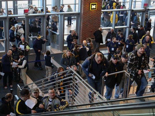Michigan fans rush in to get seats for the Signing of the Stars event at the Crisler Center in Ann Arbor on Feb. 1, 2017.