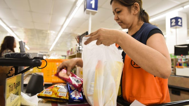 New Jersey lawmakers hope a new nickel fee on one-use plastic and paper shopping bags will curtail their use -- and generate fresh budget revenue