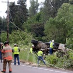 Emergency crews work to rescue a cement truck driver after a rollover crash on River Road S in Salem on Friday, May 20, 2016. The truck knocked down two power poles causing outages for nearby residents. The driver was rescued safely.