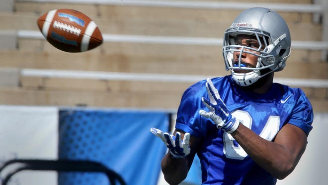 MTSU's Terry Pettis catches the ball during practice at the stadium Wednesday, Aug. 12, 2015.