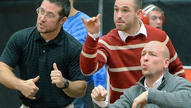 Steve Waite, back right, coaches during a Fort LeBoeuf wrestling match along with fellow assistant Justin Blose, left, and head coach Tim Simon, seated, in December 2019. Waite, a former PIAA champioin, has been hired as LeBoeuf's wrestling head coach.