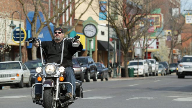 A motorcyclist rides in downtown Traverse City in 2012.