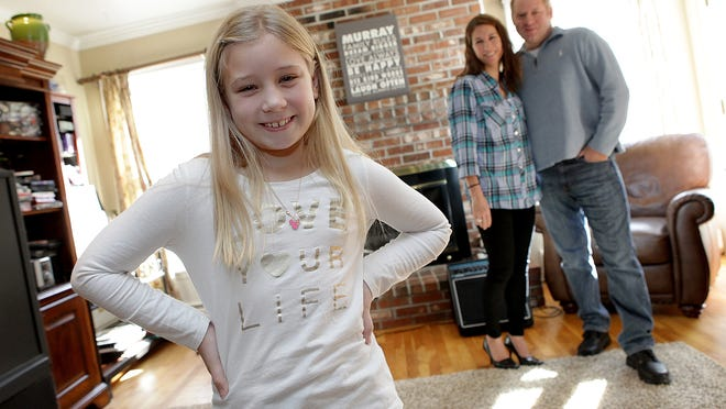 """Tori Murray, 10, of Long Valley with her parents, Jen and Tom. Tori is playing the lead role in the off-Broadway musical """"Ruthless!"""""""