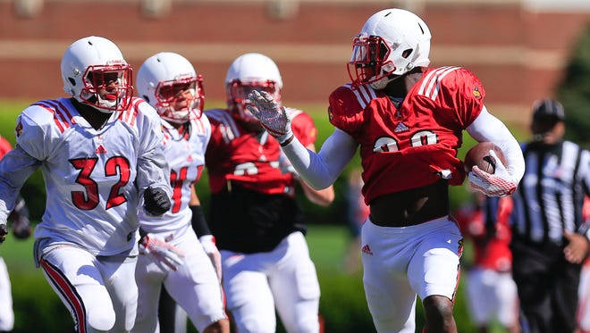 Louisville tight end Charles Standberry gets some bignyardage during a Spring scrimmage. He had seven passes for 57 yards and two touchdowns in the 2014 season as a freshman. By Matt Stone, The C-J April 11, 2015.