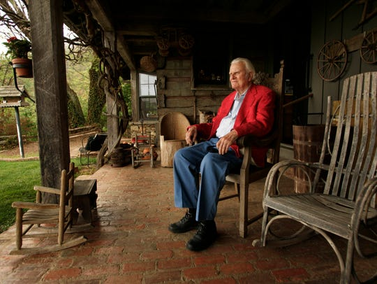The world's best-known evangelist, the Rev. Billy Graham, has died. He was 99. He was photographed on the porch of his mountaintop cabin in Montreat, N.C., on May 12, 2005.