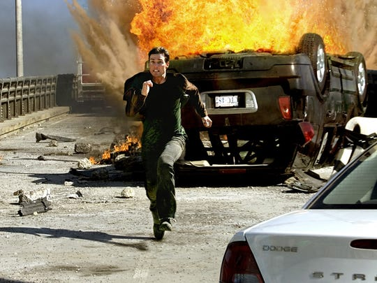Ethan Hunt (Tom Cruise) escapes a fiery situation and
