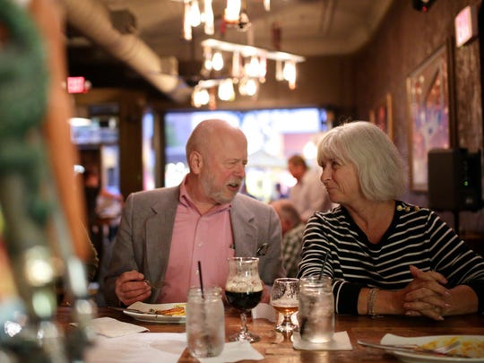 Steven Olesen and Bonita Olesen, both of Troy, chat during the Top 10 Takeover dinner at Ale Mary's.
