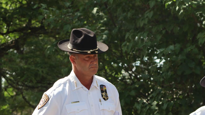 File: Madison County Sheriff Todd Hood stands with other law enforcement Wednesday, July 15, 2020, outside the Oneida County Sheriff's Office. The sheriff's office and county Board of Supervisors will host a second public forum on police reform over Zoom.
