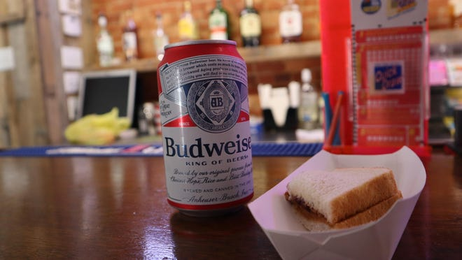 A peanut butter and jelly sandwich is served with a beer Monday, Aug. 24, 2020, at Pete's Bar on North Main Street in Herkimer.