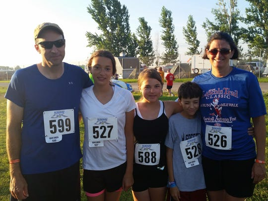 The Brandts made the EAA AirVenture Runway 5K a family event on Saturday morning.