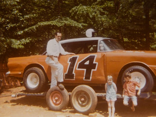 Dude Hannon is pictured with his race car in 1969.