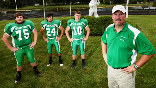 From left, Margaretta seniors Ed Huber, Austin Emmons and Tyler Henderson, along with head coach Andy Zuk, lead a young Polar Bears team into the 2015 season.