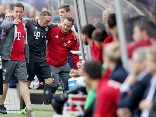 Bayern's Franck Ribery is carried off the field after getting injured during the German Bundesliga soccer match between RB Leipzig and Bayern Munich at the Red Bull Arena in Leipzig, Germany, Saturday. May 13, 2017.  (Jan Woitas/dpa via AP)