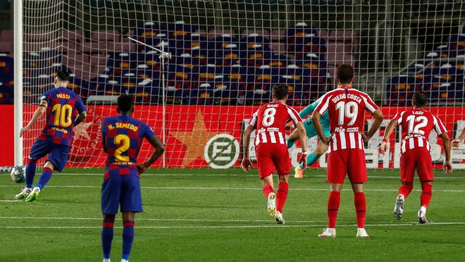 Barcelona's Lionel Messi, left, scores on a penalty kick for FC Barcelona, his 700th career goal.