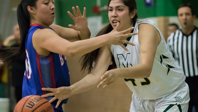 Mayfield's Alyssa Sanchez looks for the open player during girls prep basketball action against Las Cruces High School on Friday.