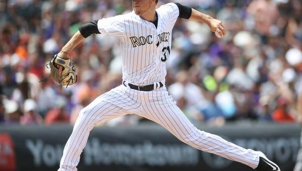 Apr 23, 2017; Denver, CO, USA; Colorado Rockies starting pitcher Kyle Freeland (31) delivers a pitch during the fifth inning against the San Francisco Giants at Coors Field. Mandatory Credit: Chris Humphreys-USA TODAY Sports