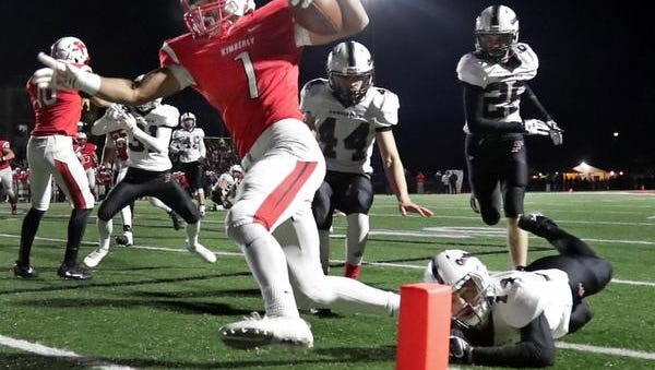 Kimberly's DJ Stewart crosses the goal line to score against Fond du Lac on Friday during a WIAA Division 1 third-round football game in Kimberly.