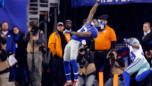 Giants wide receiver Odell Beckham pulls in a touchdown pass against the Dallas Cowboys in the first half at MetLife Stadium on Sunday night.