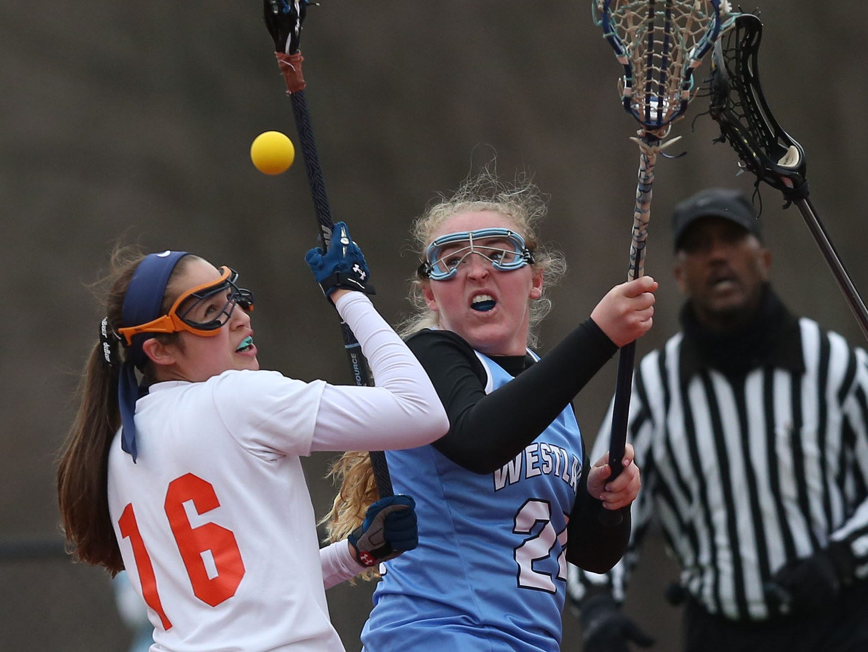From left, Briarcliff's Jordana Cohen (16) and Westlake's Lauren Holzer (24) battle for ball control during first half action in the championship game of the Mt. Pleasant Cup girls lacrosse tournament at Briarcliff High School March 24, 2016. Briarcliff won the game 15-9.