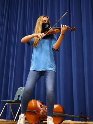 Nicole Jeter plays the violin for incoming 7th grade students attending the week-long Fort Smith Public School Strings Camp, Monday, July 27, 2020, at Ramsey Jr. High School. Offered free to all incoming 7th grade students, camps are held at Ramsey for students attending Ramsey or Chaffin Jr. High and at Northside for students attending Darby and Kimmons Jr. High. During the camp students are introduced to playing the violin, viola, cello and bass. Nicole is the 16-year-old daughter of Karen and John Jeter.