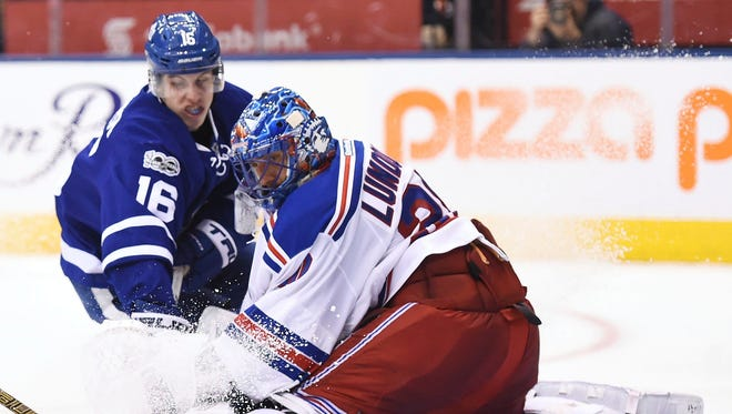 Toronto Maple Leafs center Mitchell Marner (16) is stopped by Rangers goalie Henrik Lundqvist (30) on Thursday, Jan. 19, 2017 in Toronto.