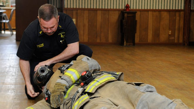 Capt. Todd Beery demonstrates the proper technique to use when treating a firefighter who has gone into cardiac arrest Thursday at the Bremen-Rushcreek Fire Department in Bremen. The department has gone through numerous changes, including the promotion of four lieutenants and becoming a 24-hour department.