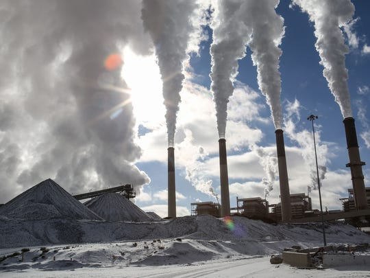 The coal-fired Jim Bridger Power Plant in southwestern Wyoming shoots steam and air pollution into the sky on Dec. 7, 2016.