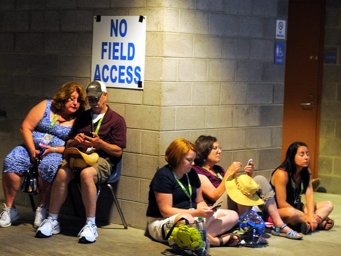 CMA Fest attendees check the radar on their cell phones at LP Field Saturday June 7, 2014, in Nashville, TN.