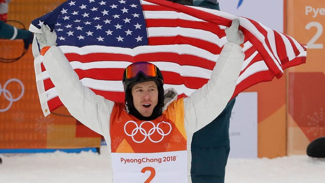 Shaun White, of the United States, celebrates his gold medal after the men's halfpipe finals at Phoenix Snow Park at the 2018 Winter Olympics in Pyeongchang, South Korea, Wednesday, Feb. 14, 2018. (AP Photo/Kin Cheung)