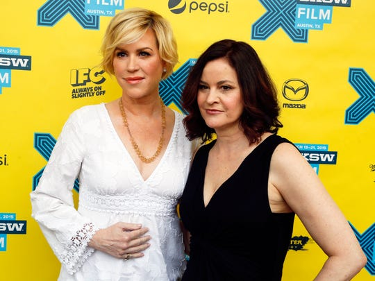 Molly Ringwald, left, and Ally Sheedy walk the red