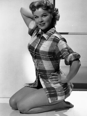 """Sally Forrest posing for a studio publicity still in 1952. Forrest, an actress-dancer who graced the silver screen throughout the `40s and `50s in MGM musicals and films such as the 1956 noir """"While the City Sleeps,"""" died on March 15, 2015 at her home in Beverly Hills, California. She was 86 and had long battled cancer."""