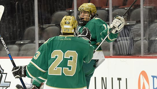Senior Dominick Posta (facing) and St. Joseph celebrated