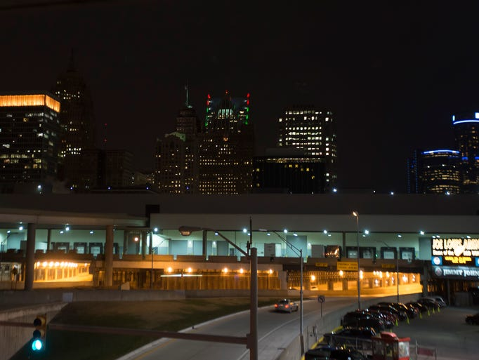 The Detroit skyline is lit up near Joe Louis Arena