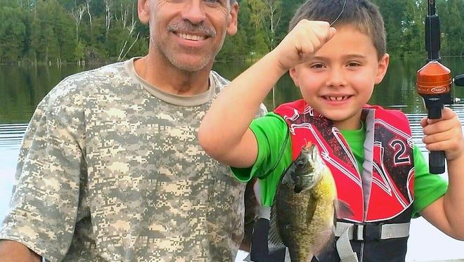 Seven-year-old Ethan Melotte's second bluegill of the night was a 'reel' trophy.
