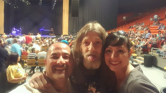"""El Paso rock concert staple Fritz """"Simon"""" Zimmerle, middle, poses for a photo with Pete Salcido and Alma Salcido-Avila during a Steve Miller Band concert July 29 at the Don Haskins Center. Zimmerle died last week."""
