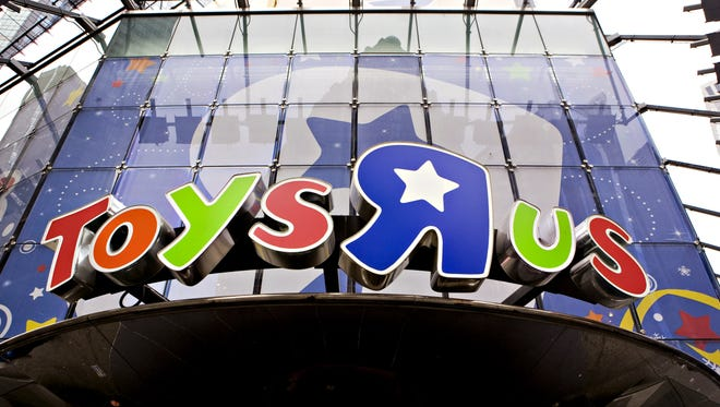 """The Toys """"R"""" Us store in Times Square in New York in  2009. A shopper at a New Jersey Toys """"R"""" Us on Friday paid the layaway bills for dozens of strangers as a holiday treat."""