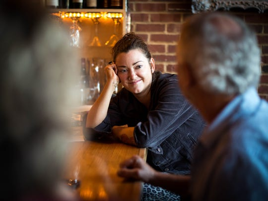 Kimberly Barlow speaks with other guests during community hour at Lockeland Table, Tuesday, Nov. 1, 2016, in Nashville, Tenn. Community hour is from 4-6pm and a portion of the proceeds go to the Lockeland Design Center PTO.