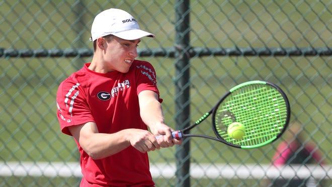 Geneva's Ryan Fishback in a singles match in  the New York State Qualifier round against Pittsford Sutherland's Harrison Mattia.