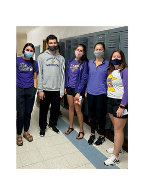 St. Mary's High School students are pictured during Mental Health Week, on purple day (in recognition of eating disorders) from left: Sydney, Jacob, Emily (Student Council President), Mckenna, and Megan.