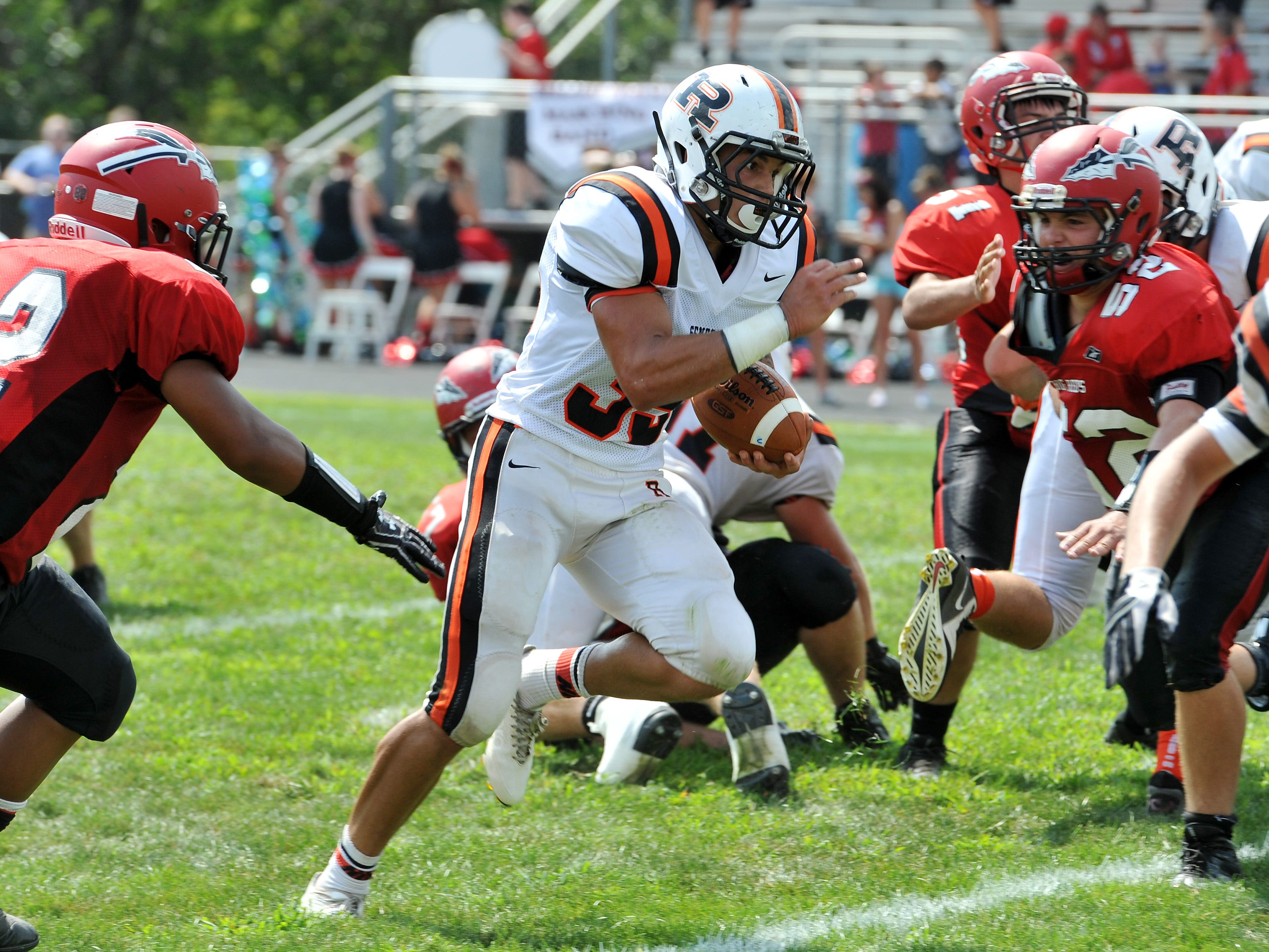 Ridgewood's Zach Donley runs through a gap on his way to the end zone against Bellaire Aug. 30.