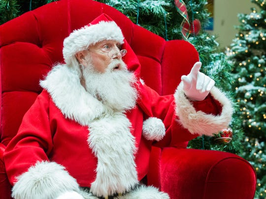 Santa prepares to visit with children on Monday, December