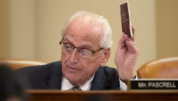 House Ways and Means Committee member Rep. Bill Pascrell Jr., D-N.J. holds up a copy of the Constitution as he speaks at the committee's meeting on Capitol Hill in Washington, Tuesday, March 28, 2017. Pascrell introduced House Resolution 186, an inquiry directing the Treasury Secretary to provide to the House of Representatives the tax returns and other specified financial information of President Donald Trump. (AP Photo/Susan Walsh)