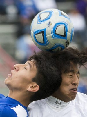 Maximiliano Frausto (left), of Mishawaka Marian, heads a ball with opponent Jesus Martinez, Cardinal Ritter, IHSAA Boys Class A State Soccer Finals, Michael A. Carroll Track & Soccer Stadium, IUPUI, Indianapolis, Saturday, Oct. 31, 2015. Mishawaka Marian High School beat Cardinal Ritter High School, 3-0.