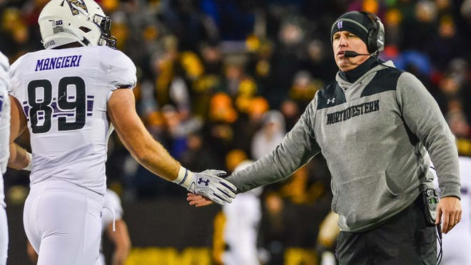 Northwestern coach Pat Fitzgerald congratulates receiver and Dunlap native Charlie Mangieri (89) during a 2018 game against the Iowa Hawkeyes at Kinnick Stadium.